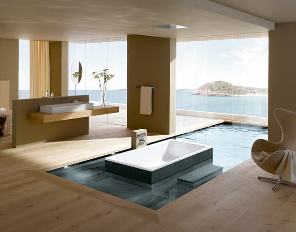 Modern bathroom with indoor and outdoor pool.