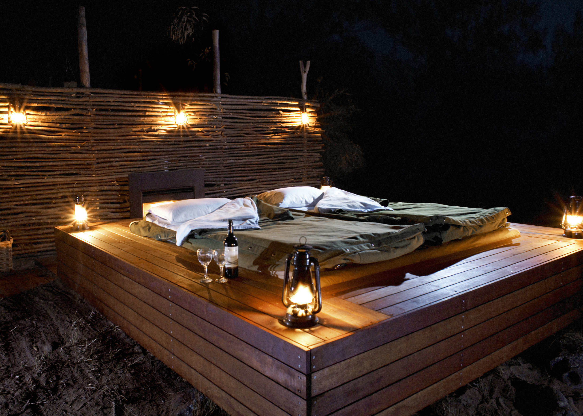 Sleep on the outdoor deck in a private deluxe safaris swag.