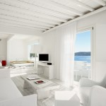 Suite bedroom with living, pool and terrace with sea view.
