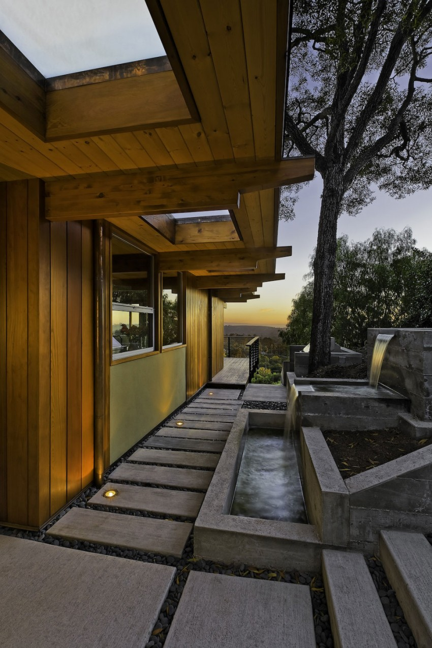 Mid century modern house is a private residence for Mid century modern water feature