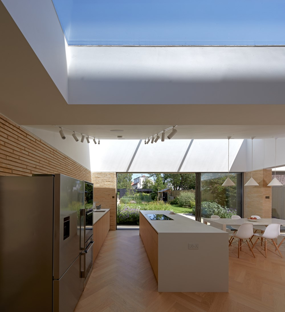 Sun Slice House and Spa by Neil Dusheiko Architects